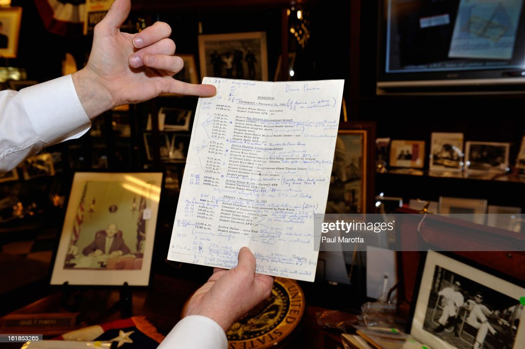 Daniel Meader of John McInnis Auctioneers holds Dave Powers' personal schedule from Texas the day JFK was assassinated at the John McInnis Presidential Auction at John McInnis Auctioneers Gallery on February 17, 2013 in Amesbury, Massachusetts.