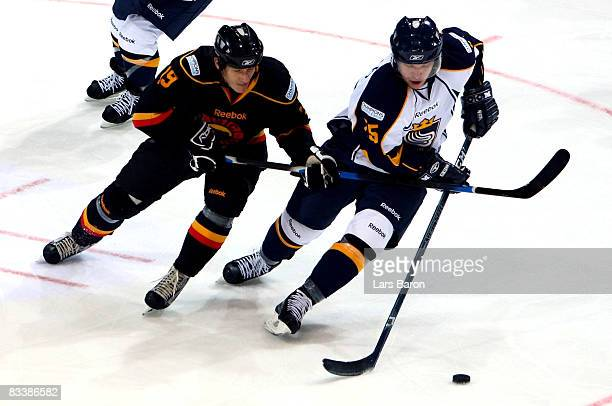 Daniel Meier of Bern in action with Ryan Keller of Espoo during the IIHF Champions Hockey League match between SC Bern and Espoo Blues at the...