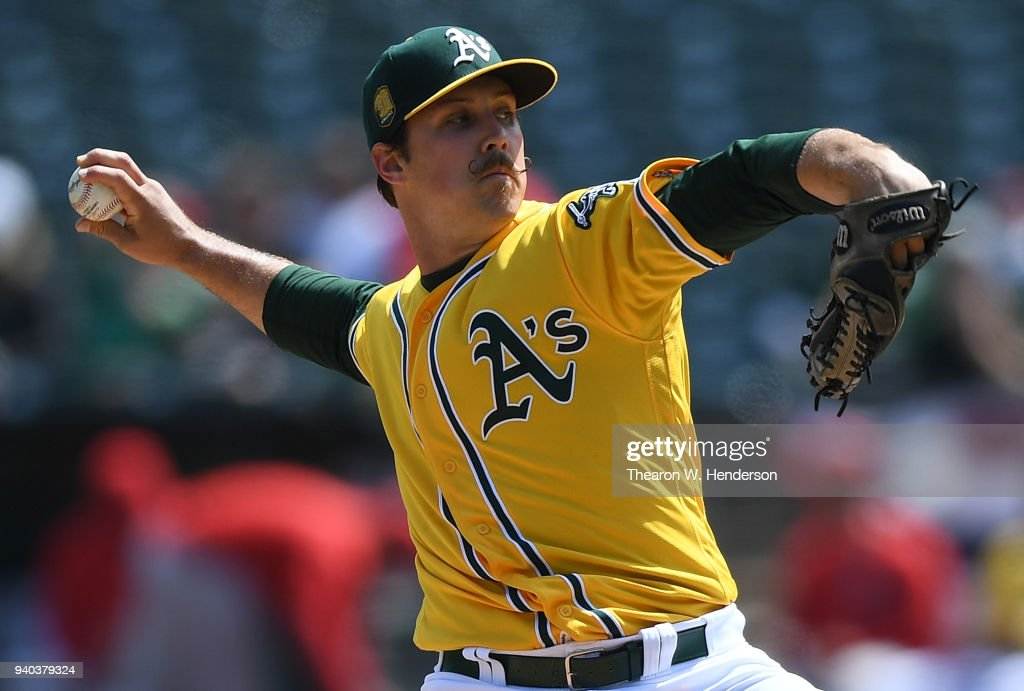 Daniel Mengden #33 of the Oakland Athletics pitches against the Los Angeles Angels of Anaheim in the top of the first inning of a Major League Baseball game at Oakland Alameda Coliseum on March 31, 2018 in Oakland, California.