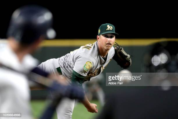 Daniel Mengden of the Oakland Athletics pitches against the Seattle Mariners in the first inning during their game at Safeco Field on September 24...