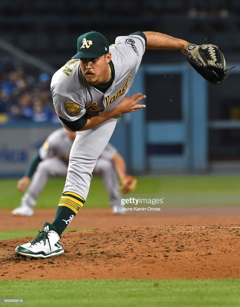 Daniel Mengden #33 of the Oakland Athletics pitches in the third inning of the game against the Los Angeles Dodgers at Dodger Stadium on April 11, 2018 in Los Angeles, California.