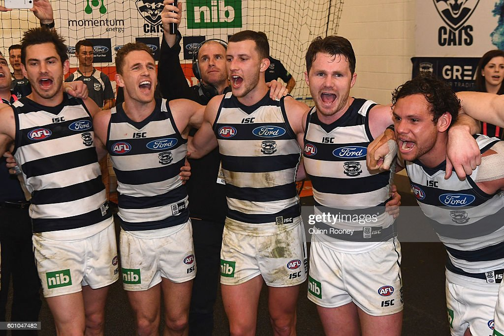 Daniel Menzel, Joel Selwood, Sam Menegola, Patrick Dangerfield and Steven Motlop of the Cats sing the song in the rooms after winning the 2nd AFL Qualifying Final match between the Geelong Cats and the Hawthorn Hawks at Melbourne Cricket Ground on September 9, 2016 in Melbourne, Australia.