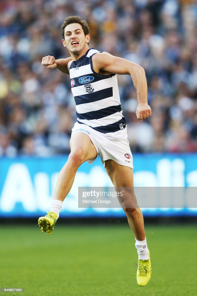 Daniel Menzel of the Cats celebrates a goal during the round two AFL match between the Geelong Cats and the Hawthorn Hawks at Melbourne Cricket Ground on April 2, 2018 in Melbourne, Australia.