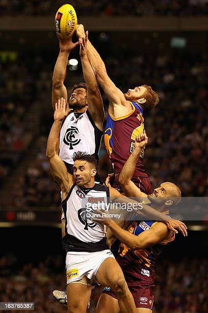 Daniel Merrett of the Lions attempts to spoil a mark by Levi Casboult of the Blues during the NAB Cup AFL Grand Final between the Carlton Blues and...
