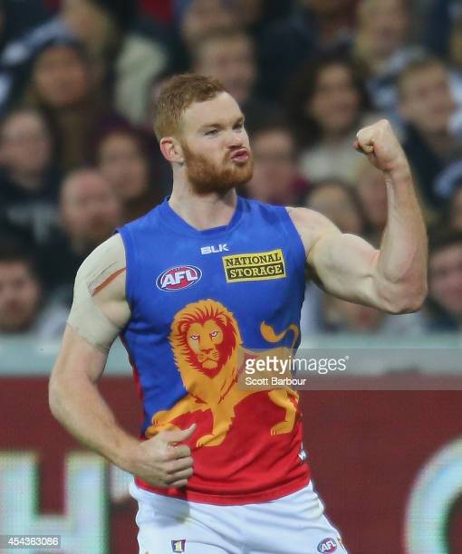 Daniel Merrett of the Lions celebrates after kicking a goal during the round 23 AFL match between the Geelong Cats and the Brisbane Lions at Simonds...