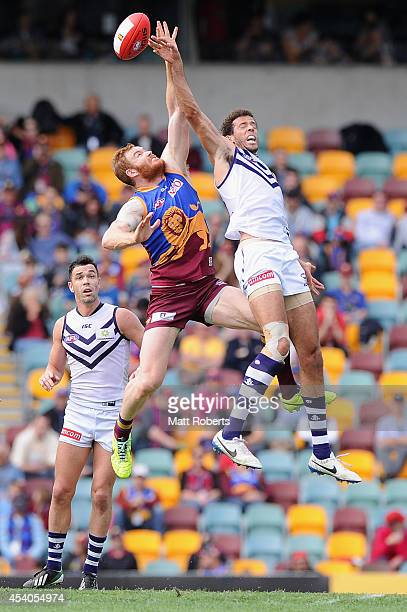 Daniel Merrett of the Lions competes for the ball with Zac Clarke of the Dockers during the round 22 AFL match between the Brisbane Lions and the...