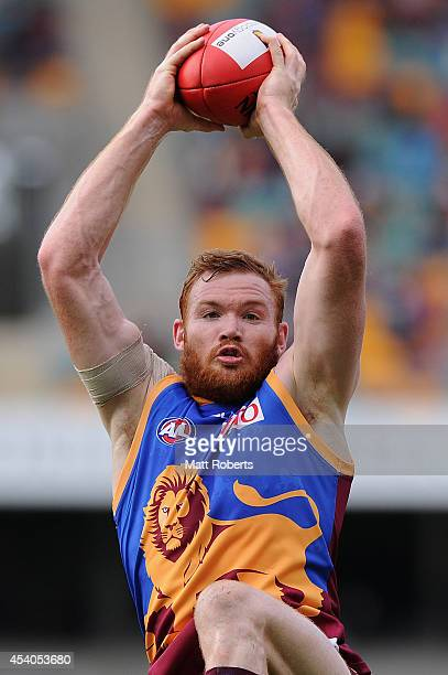 Daniel Merrett of the Lions marks during the round 22 AFL match between the Brisbane Lions and the Fremantle Dockers at The Gabba on August 24 2014...