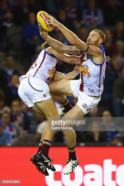 Daniel Merrett of the Lions marks infront of team mate Harris Andrews during the round five AFL match between the Western Bulldogs and the Brisbane...