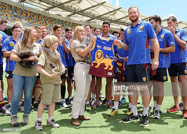 Daniel Merrett of the Lions presents Terri Iwrin with a Lions guernsey during a Brisbane Lions AFL media opportunity at The Gabba on February 3 2014...