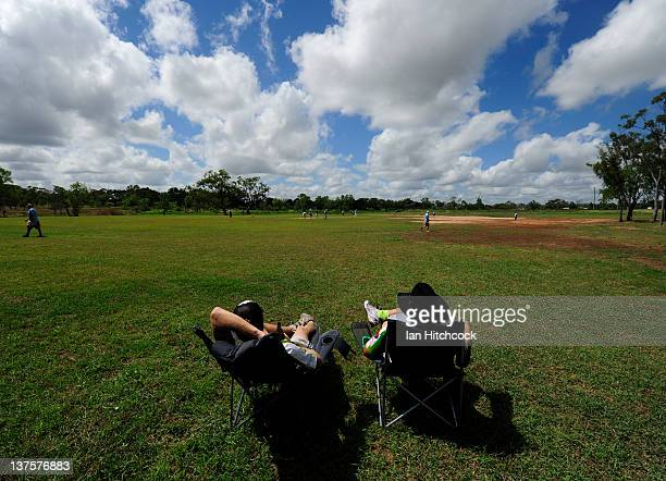 Daniel Mill and Dempsey McCoy from the team 'Wolf Pack' sit in field to score a match during the 2012 Goldfield Ashes cricket competition on January...