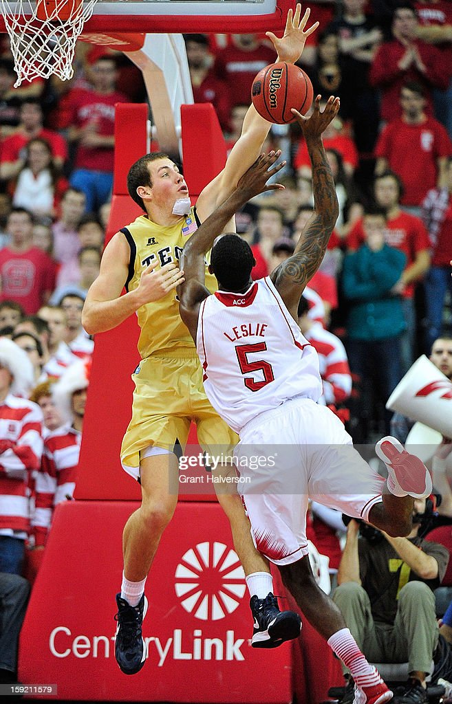 Daniel Miller #5 of the Georgia Tech Yellow Jackets blocks a shot by C.J. Leslie #5 of the North Carolina State Wolfpack during play at PNC Arena on January 9, 2013 in Raleigh, North Carolina.