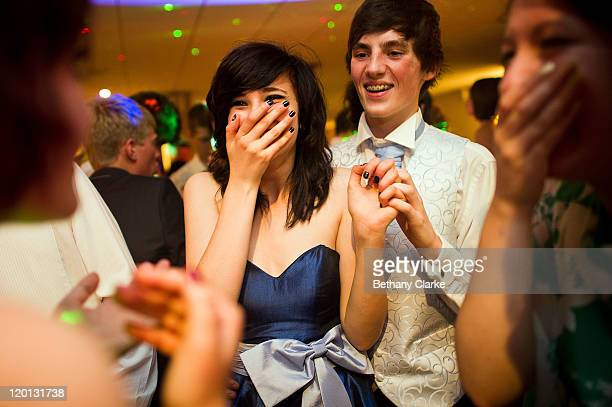 Daniel Milne and girlfriend Lauren Butler laugh as they are announced as prom king and queen at St James' Park on July 1 2011 in Newcastle United...