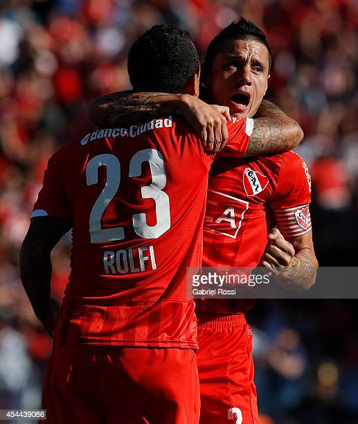 Daniel Montenegro and Cristian Tula celebrate during a match between Independiente and Racing as part of fifth round of Torneo de Transicion 2014 at...
