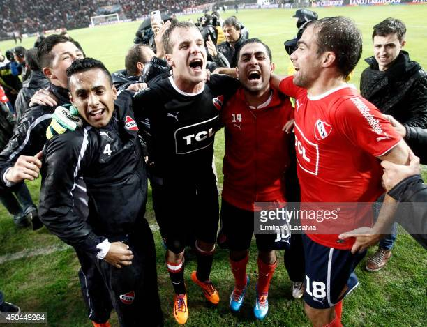 Daniel Montenegro Federico Insa and Diego Rodriguez of Independiente celebrate being promoted to first division after one year of playing in Primera...
