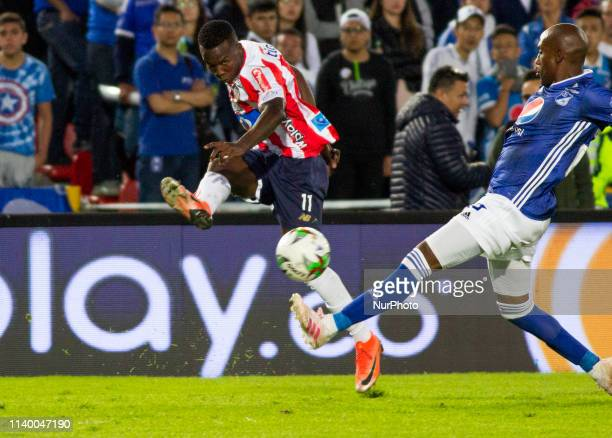 Daniel Moreno de Junior controls the ball against a player from Millonarios during a match between Millonarios and Junior as part of Torneo Apertura...