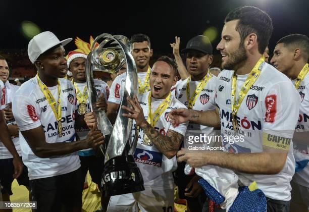 Daniel Moreno Jarlan Barrera Sebastian Viera of Junior celebrate as champions after the second leg final match of the Torneo Clausura Liga Aguila...