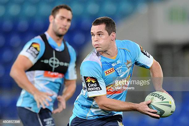 Daniel Mortimer looks to pass the ball during a Gold Coast Titans NRL training session at Cbus Stadium on June 19, 2014 on the Gold Coast, Australia.