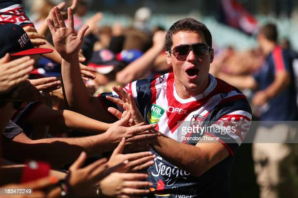 Daniel Mortimer of the Roosters celebrates with fans during a Sydney Roosters fan day at Allianz Stadium on October 7 2013 in Sydney Australia