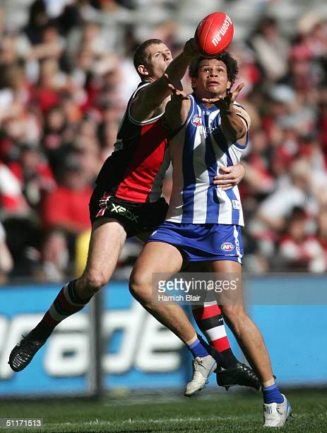 Daniel Motlop for the Kangaroos contests with Brett Voss for St Kilda during the round twenty AFL match between the Kangaroos and the St Kilda Saints...