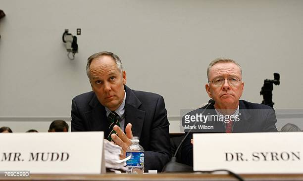 Daniel Mudd president and CEO of Fannie Mae and Richard Syron chairman and CEO of Freddie Mac listen to questions during a House Financial Services...
