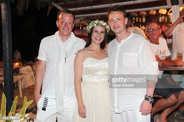 Daniel Mueksch Nikita Stromberg and Holger Stromberg attend the wedding of star chef Holger Stromberg and his wife Nikita on August 9 2014 in Ibiza...