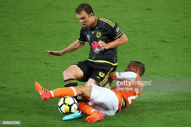 Daniel Mullen of the Phoenix and Eric Bautheac of the Roar compete for the ball during the round 10 ALeague match between the Brisbane Roar and the...