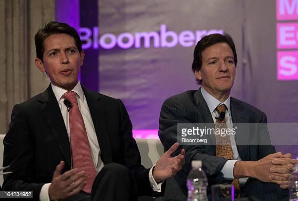 Daniel Muniz chief financial officer of Grupo Mexico SAB left speaks while Carlos Garcia Moreno chief financial officer of America Movil SAB listens...