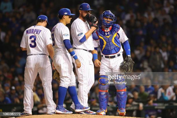 Daniel Murphy Javier Baez Jon Lester and Willson Contreras of the Chicago Cubs talk on the mound during the National League Wild Card game against...