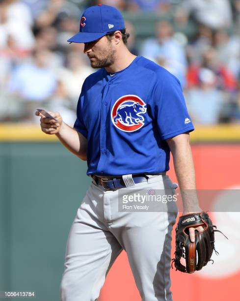 Daniel Murphy of the Chicago Cubs looks over a fielder positioning note card during the game against the Chicago White Sox on September 21, 2018 at...