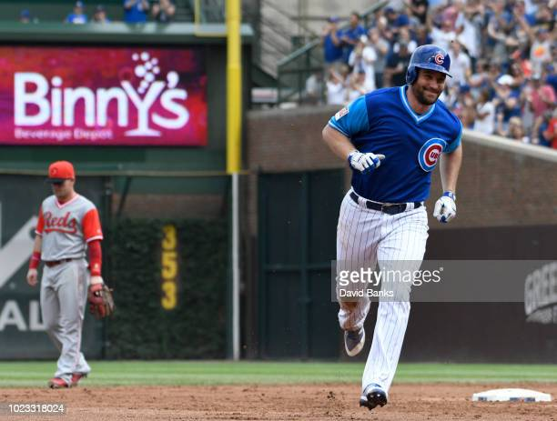 Daniel Murphy of the Chicago Cubs runs the bases after hitting a two-run home run against the Cincinnati Reds during the second inning on August 25,...