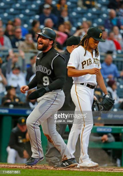 Daniel Murphy of the Colorado Rockies celebrates after scoring on a throwing error in the second inning against the Pittsburgh Pirates at PNC Park on...