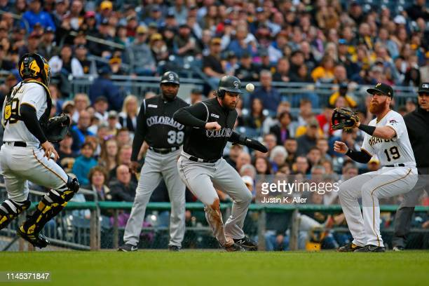 Daniel Murphy of the Colorado Rockies gets caught in a run down in the second inning against Francisco Cervelli of the Pittsburgh Pirates and Colin...