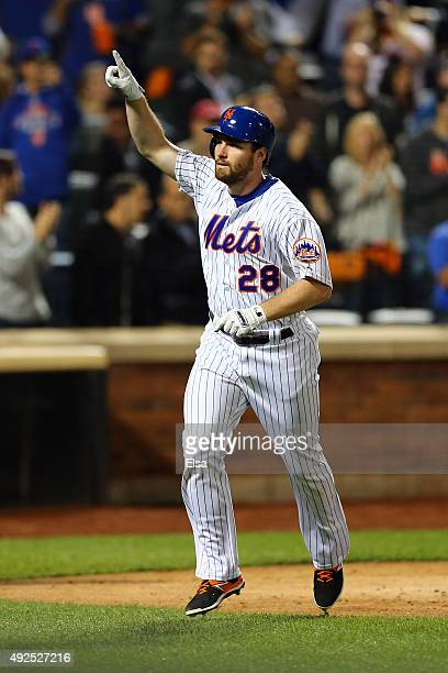 Daniel Murphy of the New York Mets celebrates after hitting a solo home run in the fourth inning against Clayton Kershaw of the Los Angeles Dodgers...