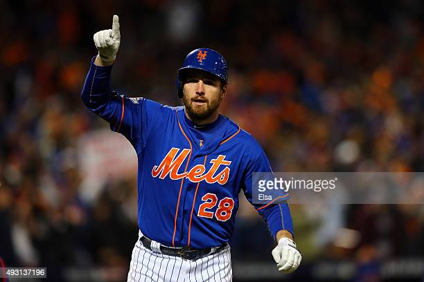 Daniel Murphy of the New York Mets celebrates after hitting a solo home run in the first inning against Jon Lester of the Chicago Cubs during game...