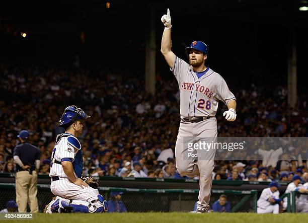 Daniel Murphy of the New York Mets celebrates after hitting a solo home run in the third inning against Kyle Hendricks of the Chicago Cubs during...