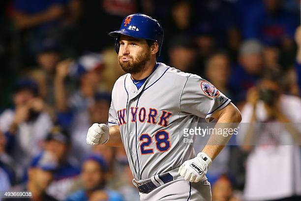 Daniel Murphy of the New York Mets celebrates after hitting a two run home run in the eighth inning against Fernando Rodney of the Chicago Cubs...