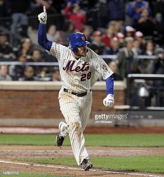 Daniel Murphy of the New York Mets celebrates his walk off single against the Washington Nationals at Citi Field on April 9 2012 in the Flushing...