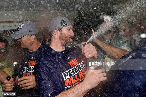 Daniel Murphy of the New York Mets celebrates in the locker room with his teammates after defeating the Chicago Cubs in game four of the 2015 MLB...