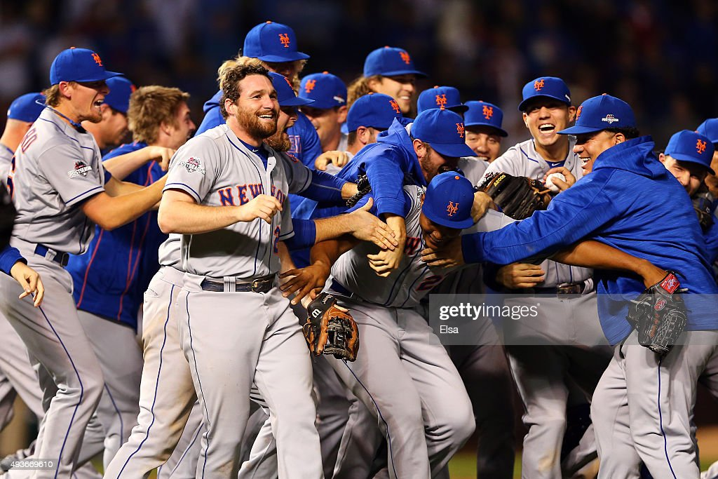 Daniel Murphy #28 of the New York Mets celebrates with his teammates after defeating the Chicago Cubs in game four of the 2015 MLB National League Championship Series at Wrigley Field on October 21, 2015 in Chicago, Illinois. The Mets defeated the Cubs with a score of 8 to 3 to sweep Championship Series.