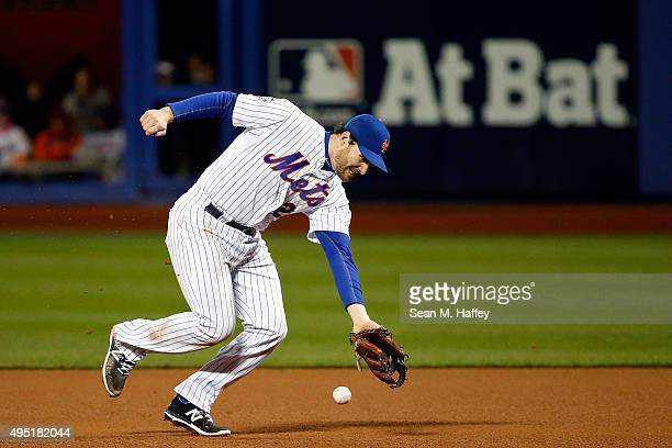 Daniel Murphy of the New York Mets fails to make a play on a ball hit by Eric Hosmer of the Kansas City Royals in the eight inning of Game Four of...