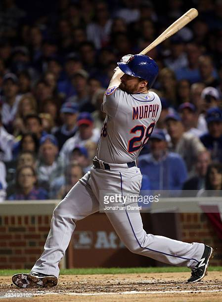 Daniel Murphy of the New York Mets hits a solo home run in the third inning against Kyle Hendricks of the Chicago Cubs during game three of the 2015...