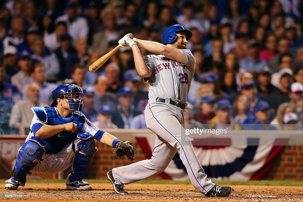 Daniel Murphy #28 of the New York Mets hits a two run home run in the eighth inning against Fernando Rodney #57 of the Chicago Cubs during game four of the 2015 MLB National League Championship Series at Wrigley Field on October 21, 2015 in Chicago, Illinois.