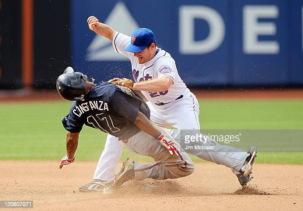 Daniel Murphy of the New York Mets is injured as Jose Constanza of the Atlanta Braves steals second base in the seventh inning at Citi Field on...