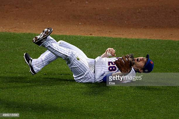 Daniel Murphy of the New York Mets makes the stop but fails to make the throw to first in the sixth inning against the Kansas City Royals during Game...