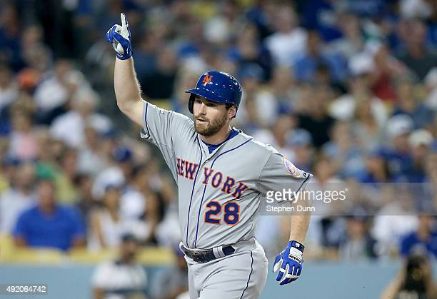 Daniel Murphy of the New York Mets reacts after he hits a solo home run in the fourth inning against the Los Angeles Dodgers in game one of the...