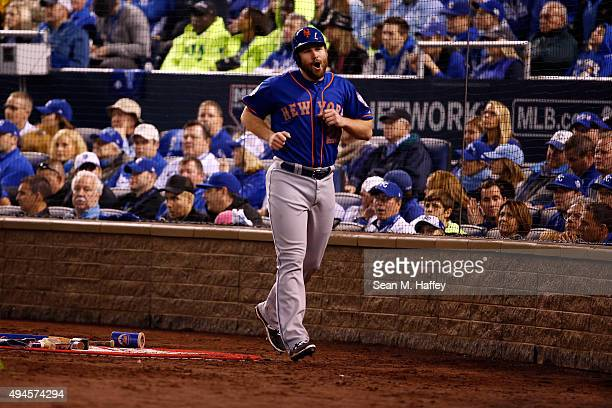Daniel Murphy of the New York Mets reacts after scoring a run on an RBI single hit by Travis d'Arnaud of the New York Mets in the fourth inning...