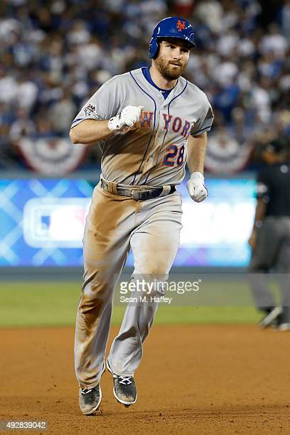 Daniel Murphy of the New York Mets rounds the bases after he hits a solo home run in the sixth inning against the Los Angeles Dodgers in game five of...