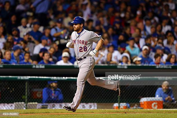 Daniel Murphy of the New York Mets rounds the bases after hitting a solo home run in the third inning against Kyle Hendricks of the Chicago Cubs...