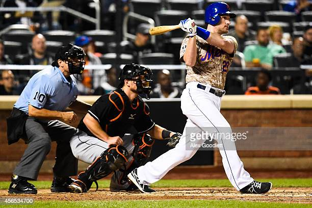 Daniel Murphy of the New York Mets swings at a pitch during a game against the Miami Marlins on September 15 2014 at Citi Field in the Flushing...