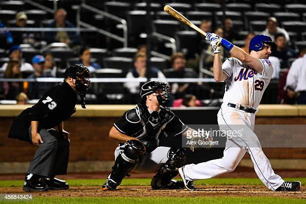 Daniel Murphy of the New York Mets swings at a pitch during a game against the Miami Marlins on September 16 2014 at Citi Field in the Flushing...